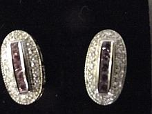 A pair of 9ct gold oval pink sapphire and diamond