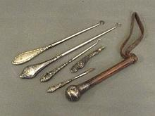 Three Hallmarked silver button hooks, two with
