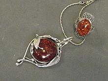 An amber style pendant and ring set