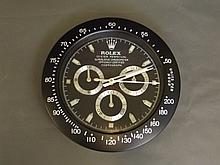 A Rolex style Daytona wall clock, 13.25