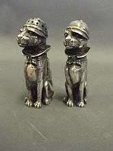 A pair of heavy silver novelty salt and pepper
