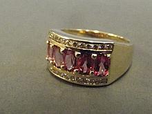 A 9ct gold diamond and five pink topaz set dress