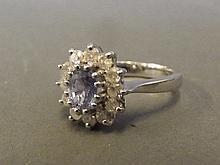 A 9ct white gold tanzanite and diamond ring, size
