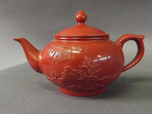 A Chinese red enamelled porcelain teapot with 6