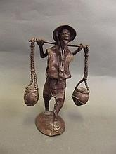 A C19th Japanese bronze figure of a farm labourer,