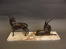 An Art Deco bronzed group of two gazelles, on a