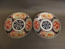 A pair of C19th Japanese Imari dishes painted with