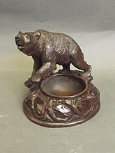 A Black Forest style ashtray surmounted by a