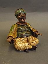 A cold painted bronze nodding figure of a portly