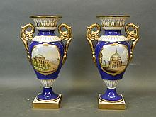 A pair of porcelain twin handled vases with blue