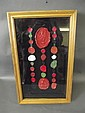 A framed display box containing various wax seals,