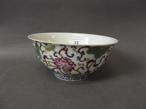 A Chinese porcelain bowl painted in enamels with