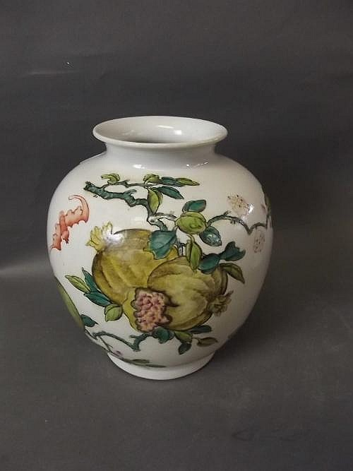 A Chinese vase with painted enamel decoration of