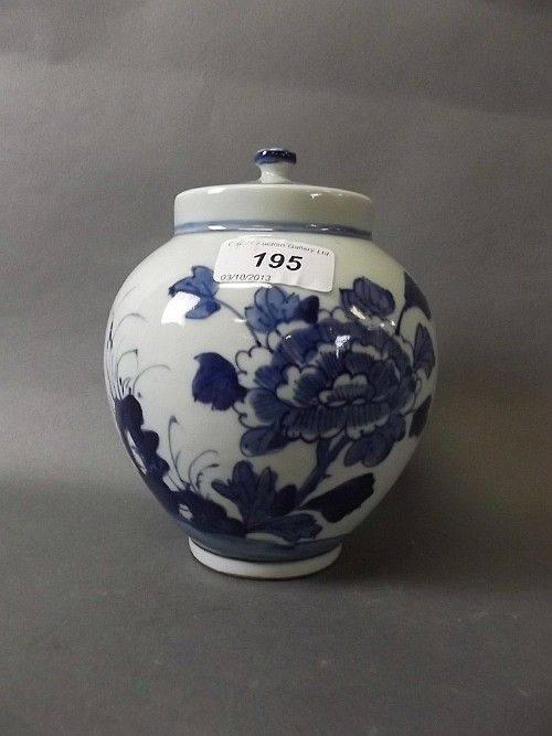 A Chinese blue and white pottery jar and cover