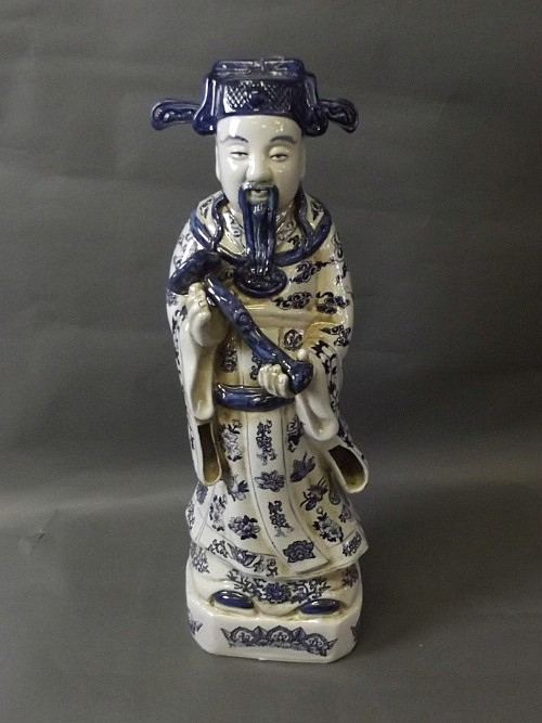 A large Chinese blue and white figure of a deity