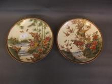A pair of early C20th Japanese Satsuma plates painted with exotic birds in river landscapes, signed, 9¼