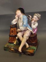A C19th Continental porcelain figure group depicting a playful child and boy, 6½