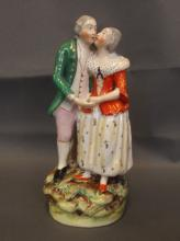 A Thomas Parr Staffordshire figure group of a courting couple standing hand in hand, circa 1880, 7½