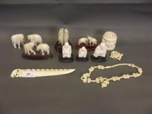 A quantity of early C20th carved ivory elephants, Buddhas, paper knives etc, 3