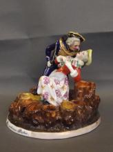 A C19th Bohemian porcelain pen holder in the form of a soldier and his lady in embrace 'Der Verlorene Posten', marked Prag, 5½