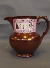 A C19th copper lustre jug with a pink lustre border to top depicting a house amongst trees, 6