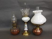 An oil lamp with a painted glass bowl and etched glass shade, and two coppe
