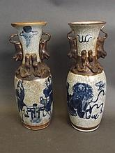 A pair of Oriental crackleglaze vases with temple lion handles, decorated w