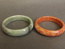 A Chinese marbled green jade bracelet, and another hardstone bracelet 2¾''