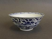 A Chinese blue and white Bisque bowl decorated with painted twin phoenix an