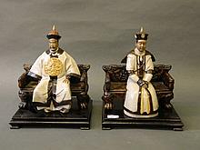 A pair of Chinese crackle glazed pottery figures of a nobleman and his wife