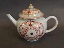 A Chinese teapot with iron red decoration, 5½'' high (AF)