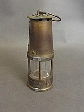 A miniature novelty coal miner's lamp by Moorgreen Colliery, 4¾'' high