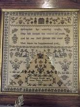 An early C19th sampler in a rosewood frame, worked by Elizabeth Bissell at