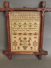 A small sampler worked by Lily Spencer at 9 years old, dated 1852, framed,