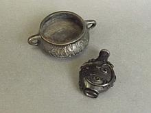 A Chinese twin handled bronze censer with impressed mark to base, and a car