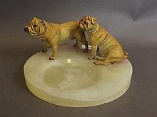 Two cold painted bronze boxer dogs mounted on a circular onyx ashtray, 8''