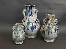 Three Continental graduated pottery vases with a mottled glaze over raised