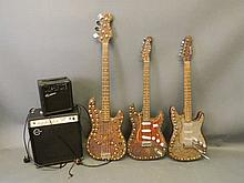 Three customised electric guitars and two amplifiers
