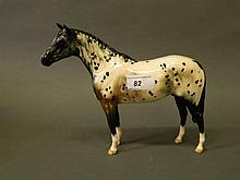 A Royal Doulton porcelain figure of a dappled horse, 8'' high