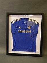 An autographed Chelsea F.C. Champion's League shirt, mounted in a presentat