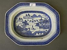A C19th Chinese porcelain dish with blue and white decoration of a river la