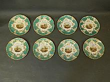 A set of eight C19th cabinet plates with turquoise borders and gilt highlig