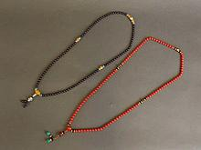 A coral bead necklace with gilt feature beads, and a garnet bead necklace w