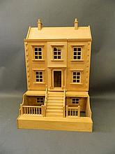 A wooden doll's house in the form of a town house with an attic and basemen