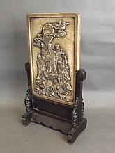 An early Chinese carved hardstone table screen depicting an Immortal and hi