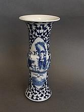 A Chinese blue and white porcelain Gu shaped vase with decorative panels de