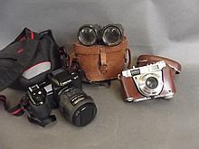 A cased Pentax 35mm camera, a Kodak Retinette 35mm camera, and a pair of bi