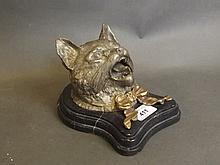 A cold painted bronze inkwell in the form of a cat's head, on a marble base