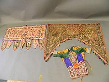 A child's jacket, a Kutch door hanging, and another similar, all embroidere