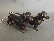 A cold painted bronze figure group of two Dachshunds, impressed 'Geschutzt'